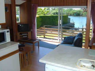 Lounge over looking the garden & river