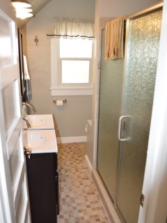 Newly Remodeled bathroom with huge walk in shower on main floor.