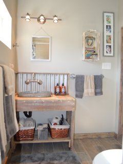 Rustic sink and vanity in 'Tin Can Alley' Bathroom.