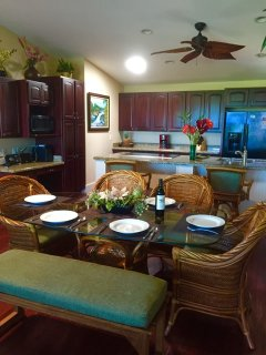 Modern kitchen with top of the line appliances, and two kitchen counter stools.