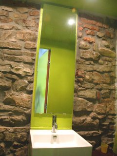 the washbasin with a medieval stone wall