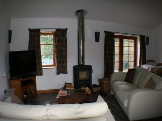 Open plan living / dining space with log fire