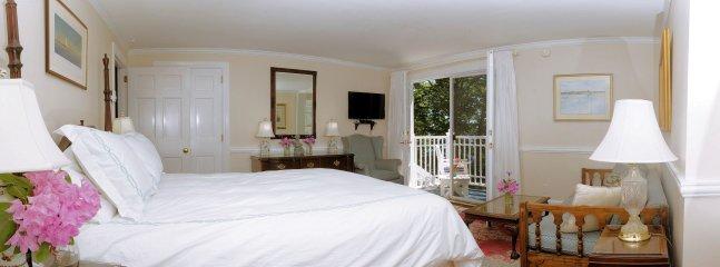 Second bedroom on second floor. French door to deck