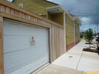side view of the property. Street parking for 3 cars. Entrance to covered parking in garage. A plus!