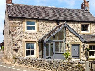 12 THE GREEN, romantic cottage, woodburning stove, patio with village views, en-suite, in Middleton Ref 16437