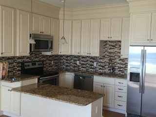 Fully-Equipped Kitchen: Stainless steel appliances and granite countertops.