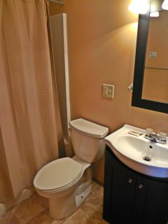 Full-sized en suite bathroom in master bedroom