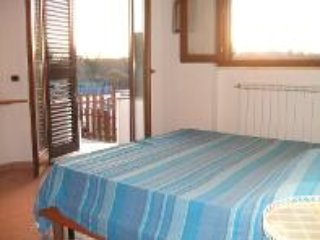 bedroom 1 with direct access to terrace and swimming pool