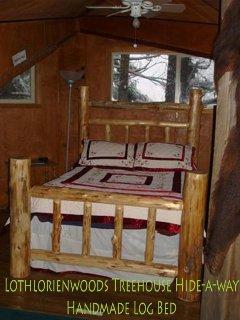 Master bedroom suite--handmade log bed, ceiling fan.