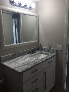 Completely renovated bath with new vanity, granite counter top.