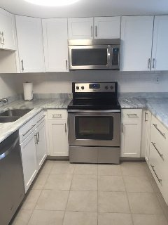 Beautifully renovated kitchen with new cabinets, all new stainless  appliances and granite counters