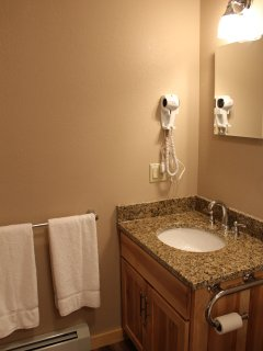 Both bathrooms are very nice and have cabinets and hairdryers