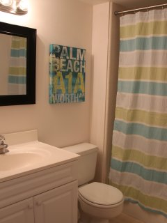 Guest bath with shower/tub; outdoor rinse showers at pool and beach walkways