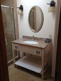 The main bathroom offers an Asian touch with tumbled marble floors and granite counter top.
