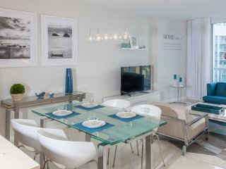 Dining area for four or five persons (table can be enlarged; extra studio chair available)