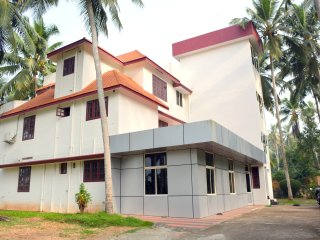 Indeevaram Apartment R3 with sea view over Trees, Kovalam