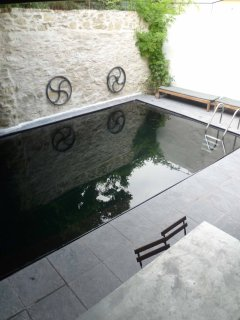 Outdoor solar heated shared pool.