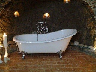 Beautiful bath in cave, candlelit, romance