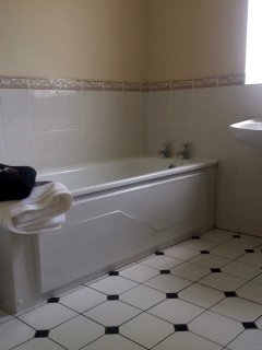 Large bathroom with bath and free standing shower