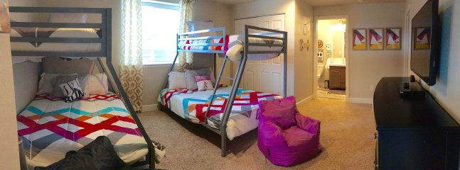 Lower level 'kids' bedroom with attached bath and full-sized washer and dryer