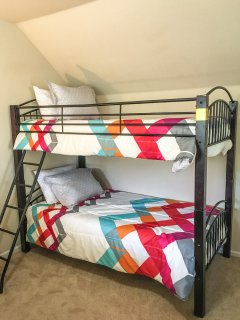 Twin bunk bed in loft