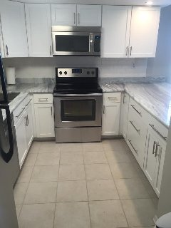 All new kitchen cabinets, stainless appliances, granite counter tops.