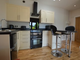 The kitchen has microwave, kettle, toaster, gas oven, extractor fan,  fridge freezer & breakfast bar