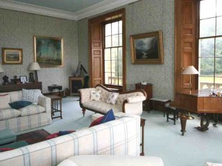 The drawing room, with authentic casement windows, and grand piano