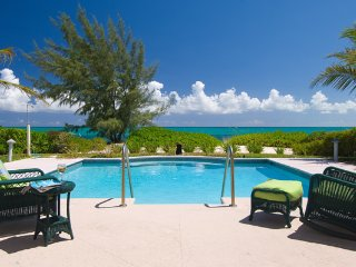 Private beachfront villa on Grace Bay sleeps 12