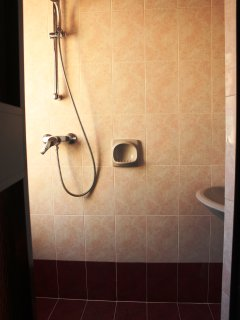 Small ensuite bathroom with shower