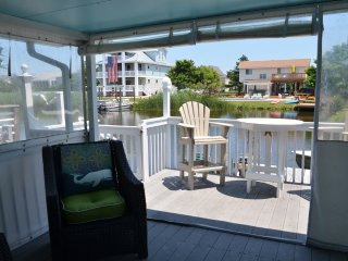 great covered porch for added living space, with a dock and shower/grilling deck.  Great view!