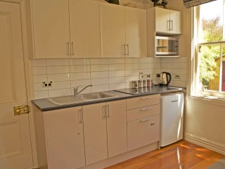 Kitchen with dishwasher and laundry