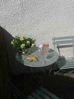 Bistro set on exterior patio. Enjoy the afternoon sun in this little sun trap!