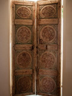 The beautiful old wooden doors of the master ensuite bathroom