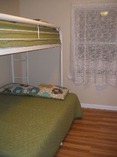 1st floor 2nd bedroom full and twin beds