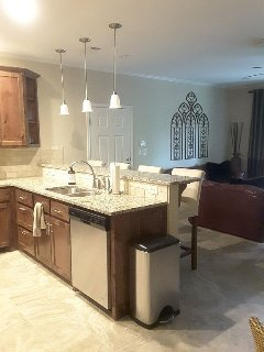 Kitchen with granite counters and stainless steel appliances.