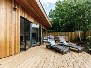 Sun loungers, dining table and chairs, plus gas barbecue enable full use of outdoor space