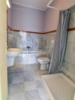 Family bathroom, all bathrooms are tiled in local Carrara marble, 2 ensuite's, shower room, 4 total.