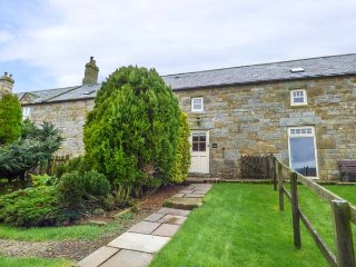 TAWNY NOOK, mid-terrace stone cottage, en-suite, woodburning stove, parking, garden, in Longframlington, Ref 935201