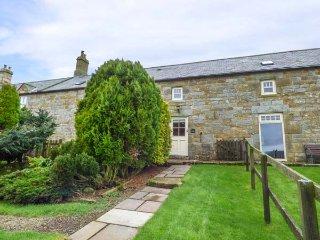 TAWNY NOOK, mid-terrace stone cottage, en-suite, woodburning stove, parking, garden, in Longframlington, Ref 935201