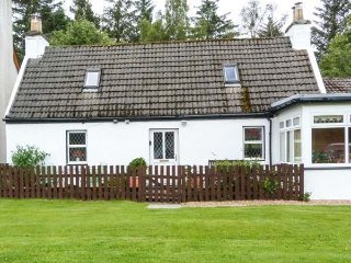 THE OLD COTTAGE AT INCHBRINE, patio with furniture, fantastic touring location,