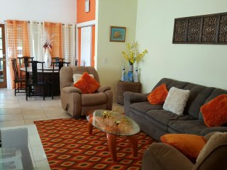 Living room with large screen TV & dinning area