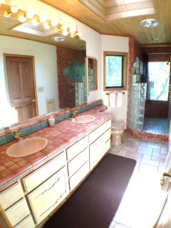 Master Bathroom with dual vanities & walk-in 2-person shower w/ massage jets.