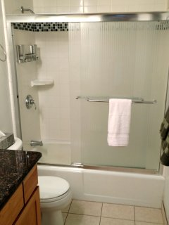 Remodeled bathroom with shower/tub.