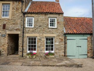 GARDEN COTTAGE, stone-built, woodburning stove, pet-friendly, romantic retreat
