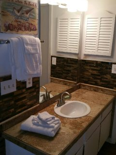 Remodeled bath with huge washer and dryer for towels!!