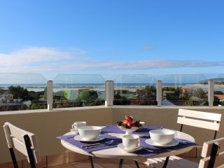 Breakfast on the lower patio, with wonderful views towards Lookout Beach and Robberg.