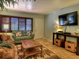 A large flat screen tv and comfy sofas in the living room