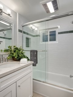 The second bathroom features a shower/tub combination.
