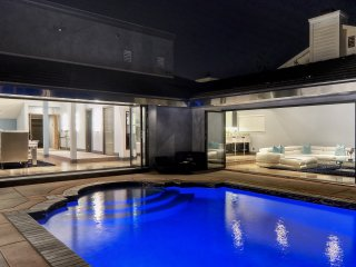 Modern luxury home patio & pool in private community. Access to private beach